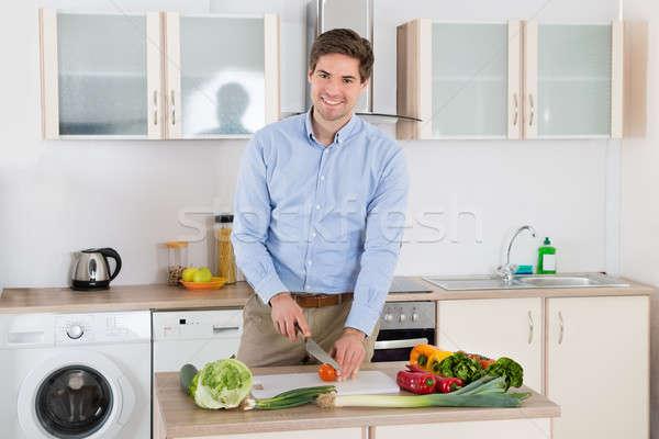 Adam sebze mutfak genç gülen Stok fotoğraf © AndreyPopov