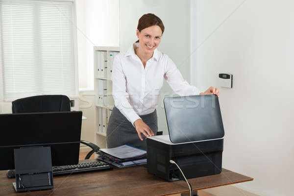Businesswoman Using Printer In Office Stock photo © AndreyPopov
