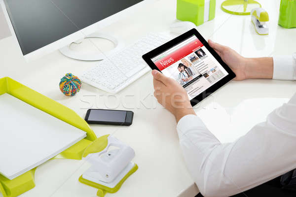 Businessperson With Digital Tablet Showing News Stock photo © AndreyPopov