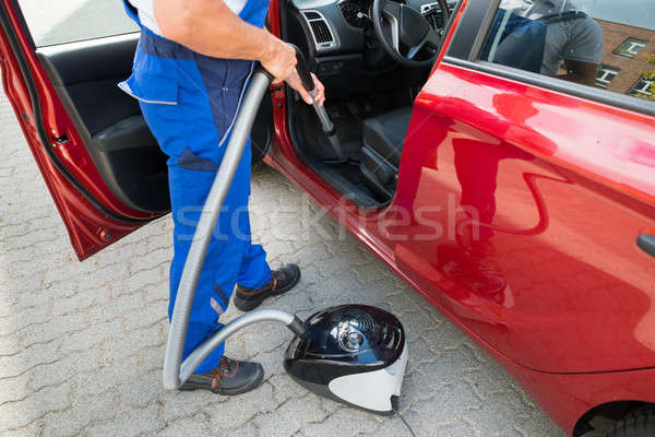 Worker Vacuuming Car With Vacuum Cleaner Stock photo © AndreyPopov