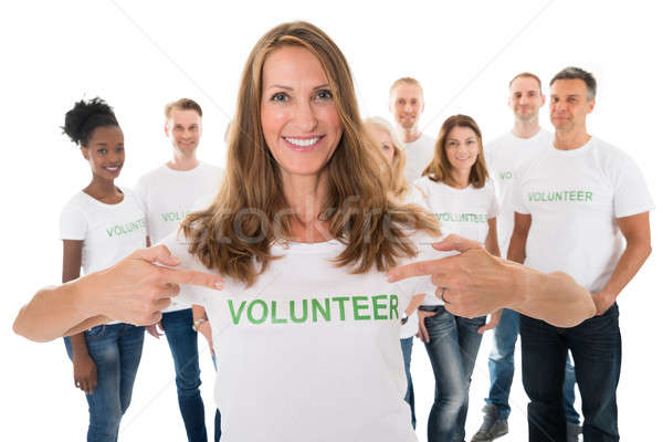 Happy Woman Showing Volunteer Text On Tshirt Stock photo © AndreyPopov