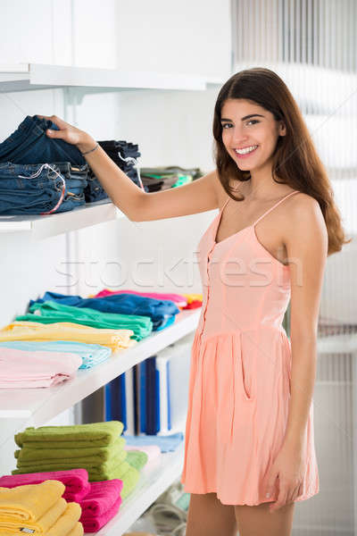 Smiling Woman Choosing Jeans In Store Stock photo © AndreyPopov