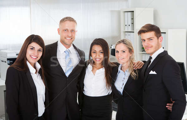 Business People Standing Arms Around In Office Stock photo © AndreyPopov