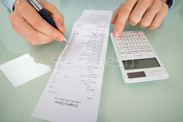 Person Hand Calculating Shopping Bill Stock photo © AndreyPopov