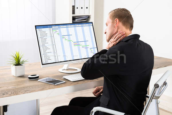 Businessman Suffering From Neck Ache Stock photo © AndreyPopov