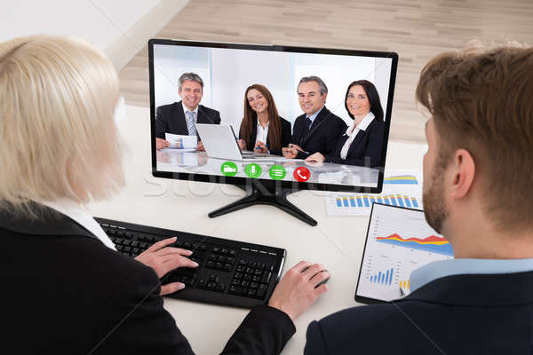 Two Businesspeople Video Conferencing On Computer Stock photo © AndreyPopov