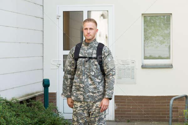 молодые мужчины солдата Постоянный за пределами дома Сток-фото © AndreyPopov
