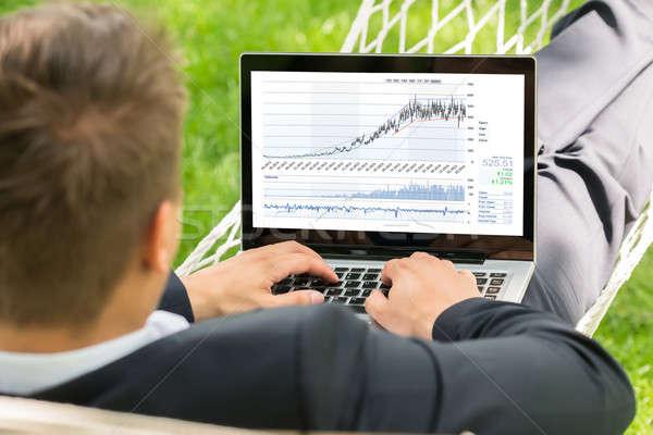 Stock bróker függőágy laptopot használ közelkép férfi Stock fotó © AndreyPopov