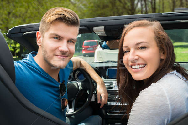 Smiling Couple Sitting In A Car Stock photo © AndreyPopov