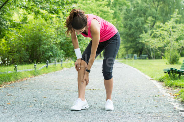 Female Jogger Having Pain In Her Leg Stock photo © AndreyPopov
