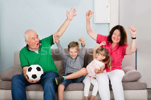 Family Watching Football Match On Television Stock photo © AndreyPopov