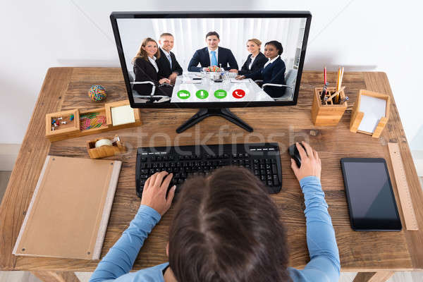 Woman Doing Video Conference With Her Colleague On Computer Stock photo © AndreyPopov