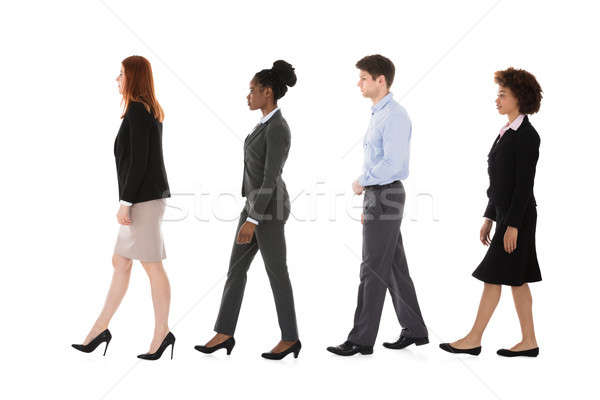 Multiracial Businesspeople Walking In Row Stock photo © AndreyPopov