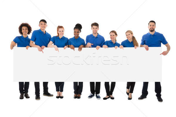 Group Of Happy Janitors Holding Long Billboard Stock photo © AndreyPopov
