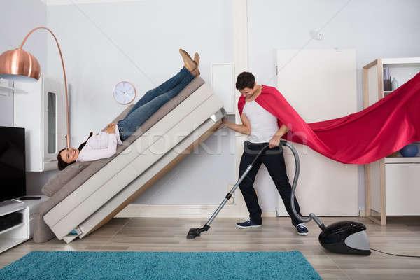 человека очистки диване пылесос молодым человеком Сток-фото © AndreyPopov