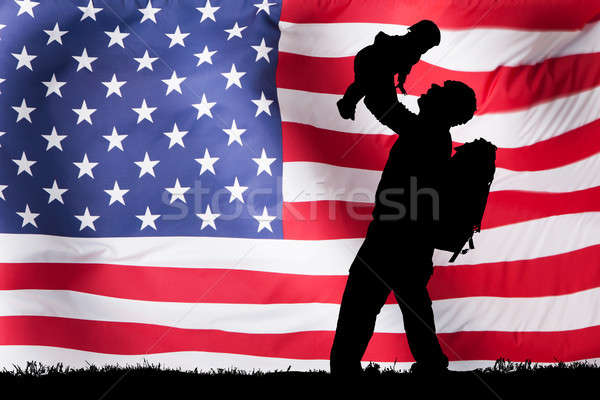Silhouette Of A Soldier Carrying His Child Stock photo © AndreyPopov