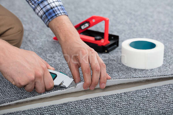 Carpenter Laying Carpet Stock photo © AndreyPopov