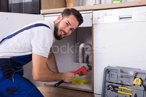 Plumber Repairing Sink Pipe Stock photo © AndreyPopov