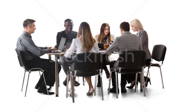 Stock photo: Diverse Group Of Businesspeople Working On Laptop
