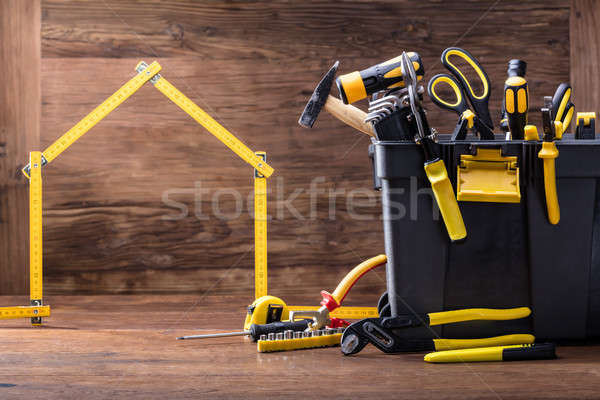 House Made Of Measuring Tape With Tools Box Stock photo © AndreyPopov