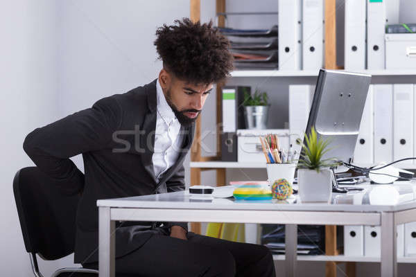 Businessman Suffering From Back Ache Stock photo © AndreyPopov