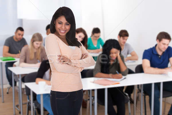 Portrait Of A Student With Folded Hands Stock photo © AndreyPopov