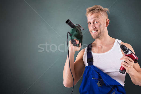 Technician Holding Electric Drill And Screwdriver Stock photo © AndreyPopov
