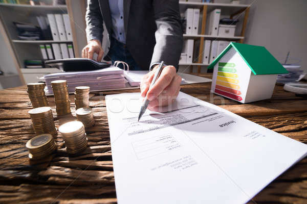 Businessperson Calculating Bill Stock photo © AndreyPopov