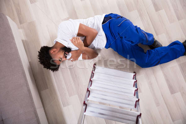 Stock photo: Handy Man Falling From Ladder In The Living Room