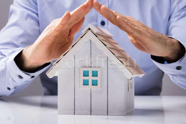 Stock photo: Human Hand Protecting House Model