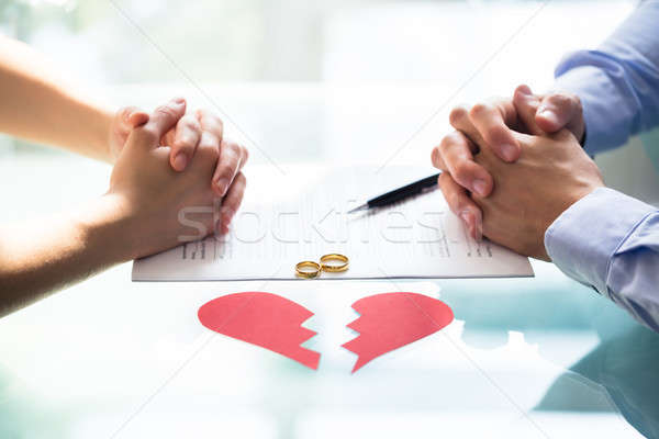 Couple's Hand On Divorce Paper Stock photo © AndreyPopov