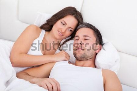 Pareja dormir cama amoroso casa sonrisa Foto stock © AndreyPopov