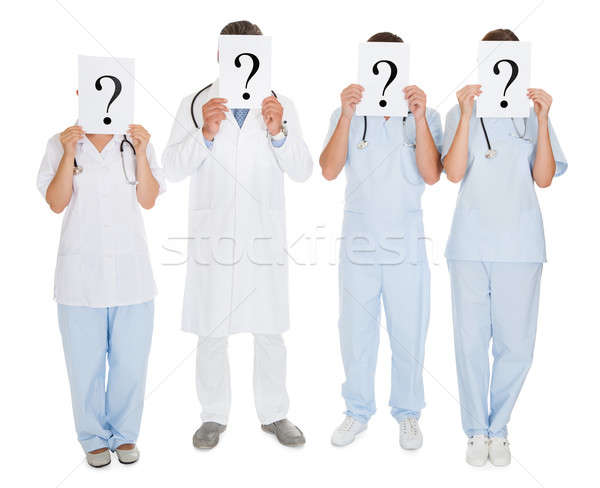 Group Of Doctors Holding Question Mark Sign Stock photo © AndreyPopov