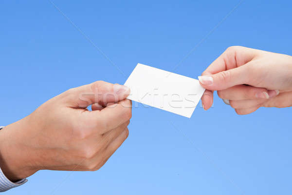Businesspeople exchanging cards over coffee Stock photo © AndreyPopov