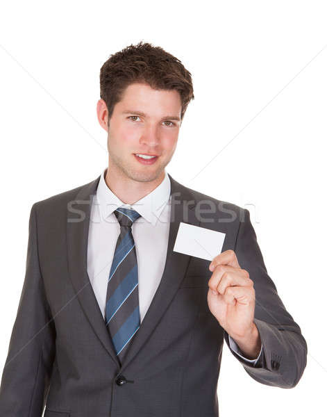 Businessman Holding Visiting Card Stock photo © AndreyPopov