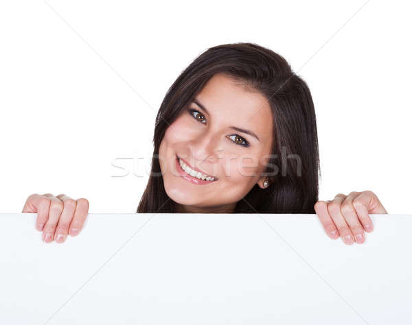 Smiling beautiful woman holding blank banner Stock photo © AndreyPopov