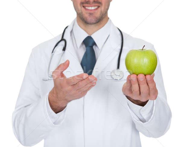 Männlichen Arzt halten grünen Apfel Porträt jungen Stock foto © AndreyPopov