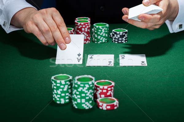 Croupier arranging cards Stock photo © AndreyPopov