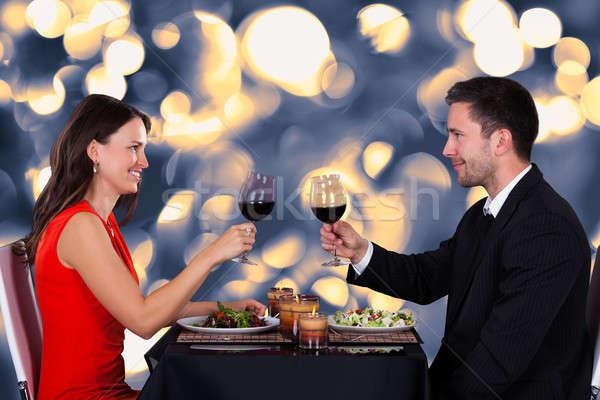 Happy Couple In Restaurant Stock photo © AndreyPopov