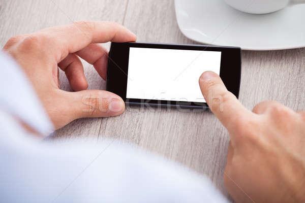 стороны смартфон экране столе Сток-фото © AndreyPopov