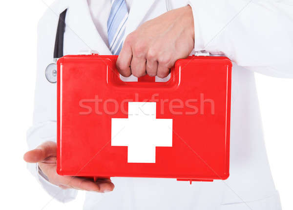 Doctor Holding First Aid Box Stock photo © AndreyPopov
