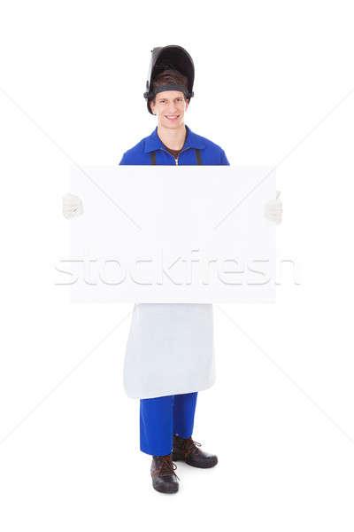 Férfi hegesztő tart plakát portré fiatal Stock fotó © AndreyPopov