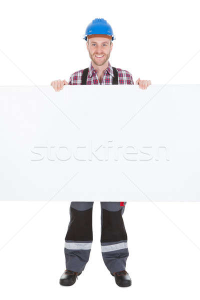 Confident Manual Worker Holding Billboard Stock photo © AndreyPopov