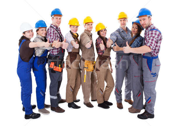 Diverse group of workmen giving a thumbs up Stock photo © AndreyPopov