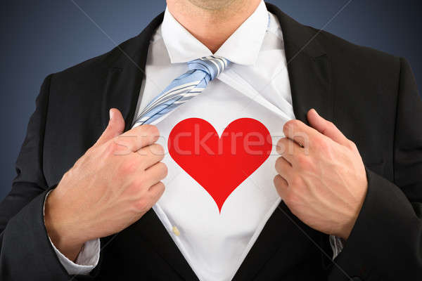 Businessman Pulling His Shirt Showing Heart Shape Symbol Stock photo © AndreyPopov