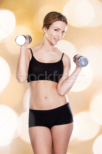 Fit Woman In Innerwear Lifting Dumbbells Stock photo © AndreyPopov