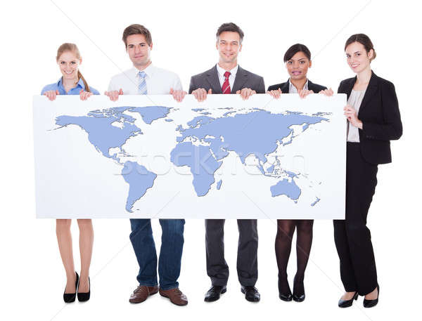 Portrait Of Confident Businesspeople Holding Worldmap Stock photo © AndreyPopov