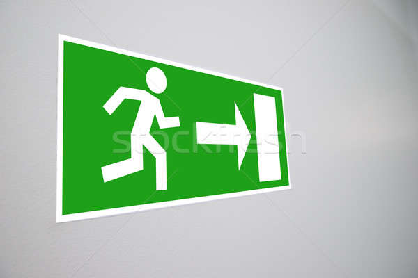 Close-up Of Emergency Evacuation Sign Stock photo © AndreyPopov