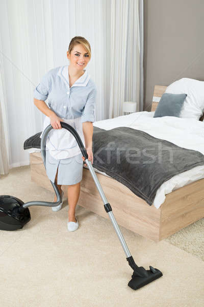 Housekeeper Cleaning With Vacuum Cleaner Stock photo © AndreyPopov