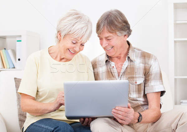 Senior Couple Looking At Laptop Stock photo © AndreyPopov